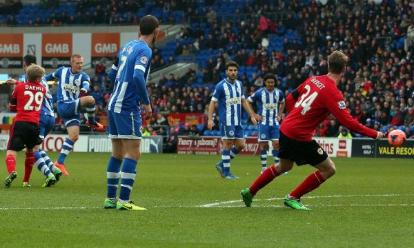 STUNNING STRIKE: Wigan midfielder Ben Watson (third left) scores their second goal from a free kick during the English FA Cup fifth round football match against Cardiff. Cardiff won 2-1. AFPpic