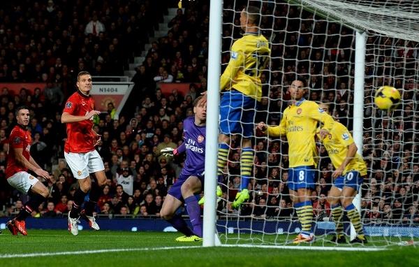 FLASHBACK: Former Gunner Robin van Persie's (left) header settled the match at Old Trafford in November. United won 1-0. AFPpic