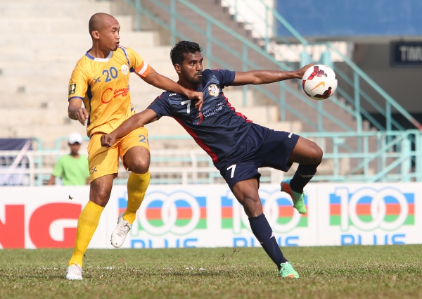 Hattrick hero Ashfaq Ali (right) attempts a left foot volley while under pressure. Picture by KAMARUL AKHIR/asiana.my