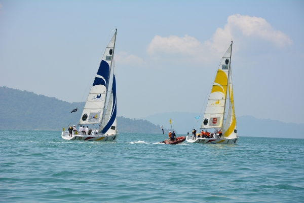 Koo (blue) and Masyuri try to ouwit each other on the waters of Langkawi today.