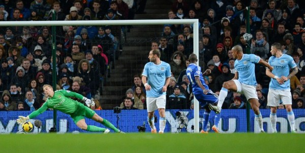 NO CHANCE: Manchester City Joe Hart (eft)  fails to stop the ball going into the net off a kick from Chelsea's Branislav Ivanovic (not pictured). Chelsea won 1-0. AFPpic