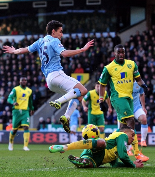 Norwich's Martin Olsson (centre) blocks a shot by Manchester City's Jesus Navas in their goalless draw at Carrow Road. AFPpic