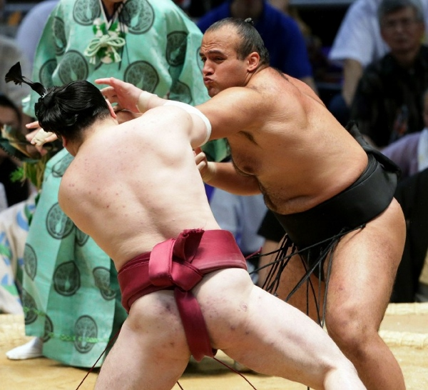 'Osunaarashi' (right) in action against Japanese wrestler Oniarashi in Nagoya, July last year. The Arab world's first professional sumo wrestler says he wants to make the sport famous among 'his people'. AFPpic