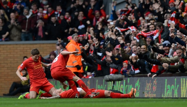 Skrtel (lying on the ground) celebrates with teammates after scoring his second goal. AFPpic