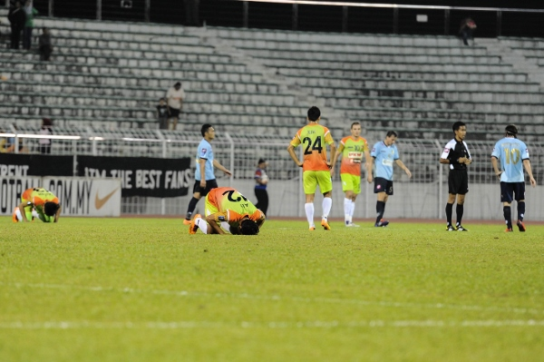 Some of PKNS' players, including Ally Imran (second from right) kiss the ground in delight after beating Forces in the league. Picture by MOHD ADIB HAKIMsports247.my