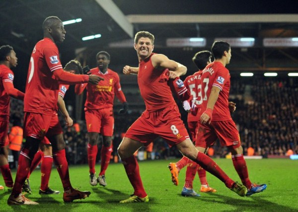 I DID IT: Liverpool captain Steven Gerrard (centre) celebrates scoring their third goal against Fulham. The Reds won 3-2 in the English Premier League. AFPpic