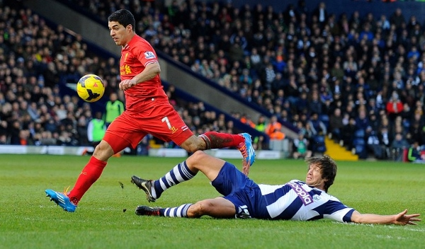 Suarez (left) breaks free from countryman Diego Lugano at the Hawthorns. AFPpic
