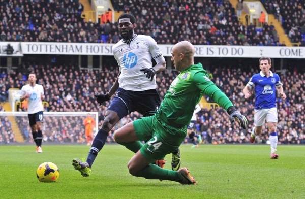 Emmanuel Adebayor's (white) solitary goal gave Spurs a priceless win in their pursuit of fourth place/AFP pic.