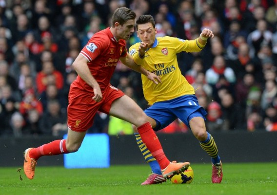 Arsenal (yellow) will be desperate to turn the tables on Liverpool after their 5-1 mauling last weekend/AFP pic.