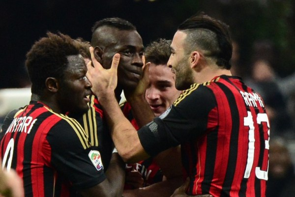 Balotelli (second from left) mobbed by teammates after his stunning strike against Bologna.
