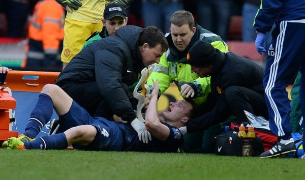 Manchester United's Phil Jones being treated after a clash of heads with Jonathan Walters/AFP pic.