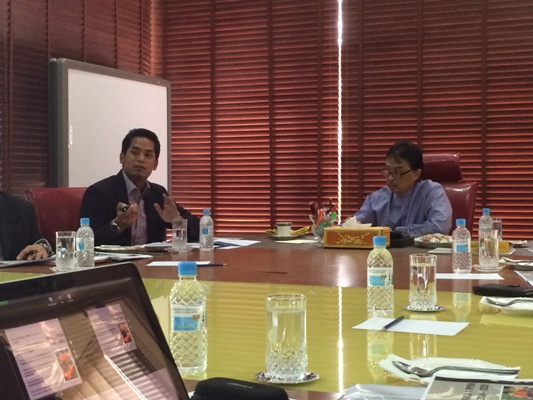 Khairy Jamaluddin (left) presenting the NFDP to FAM deputy president Tengku Abdullah Sultan Ahmad Shah.