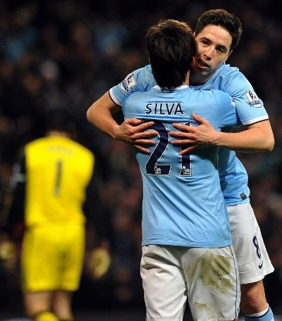 Man City celebrate their second goal against Spurs/AFP pic.